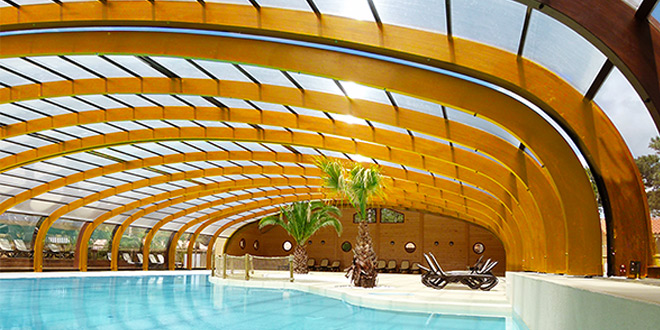 Sun abris la r f rence de l 39 abri piscine bois for Abri de piscine ossature bois